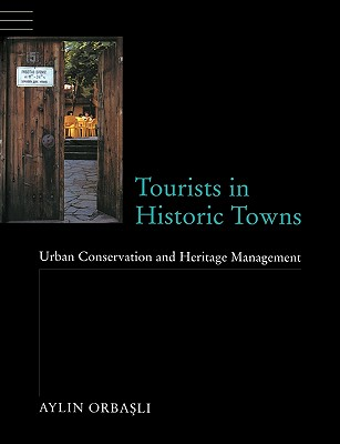 Image for Tourists in Historic Towns: Urban Conservation and Heritage Management